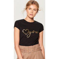 Koszulka z połyskującym nadrukiem - Czarny. Brązowe t-shirty damskie marki Mohito, m. Za 69,99 zł.