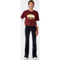 """Koszulka """"Evansville"""". Niebieskie t-shirty damskie marki Pull&Bear. Za 49,90 zł."""