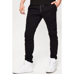 Spodnie męskie: Joggery z elastycznego materiału - Czarny