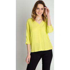 Bluzki, topy, tuniki: Żółta bluzka z dekoltem w literkę V BIALCON