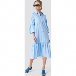 NA-KD Boho Sukienka koszulowa z bufiastym rękawem - Blue. Niebieskie sukienki boho marki NA-KD Boho, na imprezę, w koronkowe wzory, z koronki, na ramiączkach, mini. Za 121,95 zł.