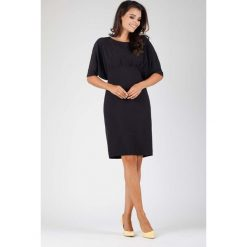 Czarna Stylowa Sukienka z Kimonowym Rękawem. Czarne sukienki balowe Molly.pl, na spotkanie biznesowe, l, oversize. W wyprzedaży za 124,53 zł.