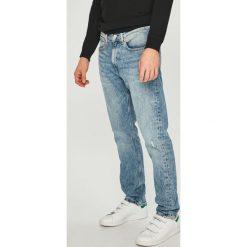 Calvin Klein Jeans - Jeansy CKJ 056. Niebieskie jeansy męskie z dziurami Calvin Klein Jeans. Za 579,90 zł.