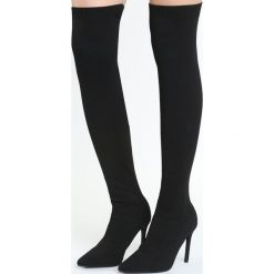 Czarne Kozaki Appearance. Czarne buty zimowe damskie marki Born2be, ze szpiczastym noskiem, na wysokim obcasie, na szpilce. Za 149,99 zł.