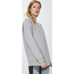 Reebok - Bluza. Szare bluzy damskie marki Reebok, l, z dzianiny, z okrągłym kołnierzem. W wyprzedaży za 229,90 zł.