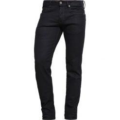 GStar 3301 LOW TAPERED Jeansy Zwężane black pintt stretch denim. Czarne jeansy męskie G-Star. W wyprzedaży za 356,85 zł.