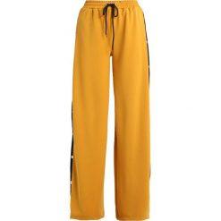 Spodnie dresowe damskie: Missguided POPPER WIDE LEG Spodnie treningowe mustard
