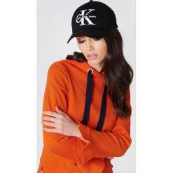 Calvin Klein Czapka baseballowa Re-Issue - Black. Czarne czapki zimowe damskie Calvin Klein, z nadrukiem. W wyprzedaży za 88,17 zł.