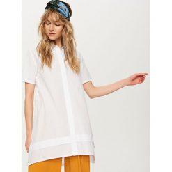 Długa koszula - Biały. Białe koszule damskie marki Reserved, z długim rękawem. Za 69,99 zł.
