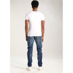 GStar ARC 3D SLIM Jeansy Slim Fit firro denim. Niebieskie jeansy męskie G-Star. W wyprzedaży za 419,25 zł.