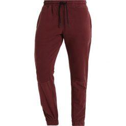 Spodnie dresowe męskie: New Look CONTRAST PANNEL ZIP  Spodnie treningowe dark burgundy