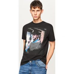 T-shirt z filmowym nadrukiem - Czarny. Czarne t-shirty męskie z nadrukiem marki B'TWIN, na jesień, m, z elastanu. Za 59,99 zł.