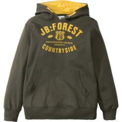 Bluza z kapturem bonprix ciemnooliwkowy z nadrukiem. Szare bluzy chłopięce rozpinane marki FOREST, na jesień, z aplikacjami, z bawełny. Za 54,99 zł.