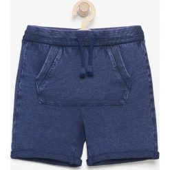 Krótkie spodenki dresowe - Granatowy. Niebieskie dresy chłopięce marki Reserved, z dresówki, krótkie. W wyprzedaży za 29,99 zł.