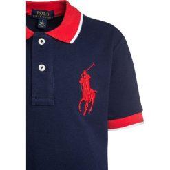 Polo Ralph Lauren BIG  Koszulka polo newport navy. Niebieskie bluzki dziewczęce bawełniane marki Adidas, z kontrastowym kołnierzykiem, z krótkim rękawem. Za 269,00 zł.