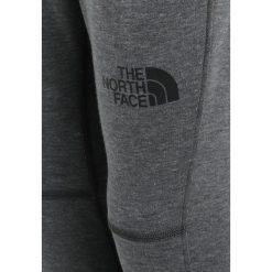The North Face SLACKER PANT Spodnie treningowe med grey heather. Szare spodnie chłopięce The North Face, z bawełny. Za 149,00 zł.