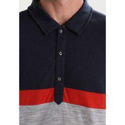 Koszulki sportowe męskie: super.natural THREE TONE Koszulka sportowa blue black/flame red/ash melange