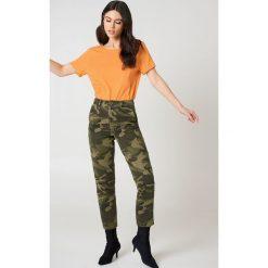NA-KD Basic T-shirt z odkrytymi plecami - Orange. Pomarańczowe t-shirty damskie NA-KD Basic, z bawełny, z dekoltem na plecach. W wyprzedaży za 21,18 zł.