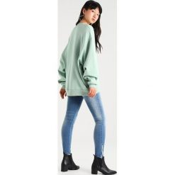 Bluzy damskie: Tommy Jeans Bluza aqua foam