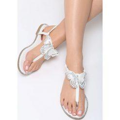 Białe Sandały Uniqueness. Białe sandały damskie marki Born2be, z materiału, na obcasie. Za 59,99 zł.