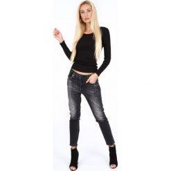 Czarne jeansy na co dzień RR71160. Czarne jeansy damskie marki Fasardi, m, z dresówki. Za 169,00 zł.