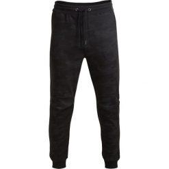 Spodnie dresowe męskie SPMD604 - multikolor - Outhorn. Czarne spodnie dresowe męskie Outhorn, na lato, z bawełny. W wyprzedaży za 79,99 zł.