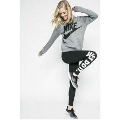 Nike Sportswear - Legginsy. Różowe legginsy we wzory marki Nike Sportswear, l, z nylonu, z okrągłym kołnierzem. Za 119,90 zł.