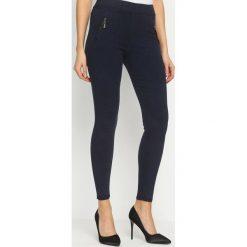 Spodnie damskie: Granatowe Legginsy Useful