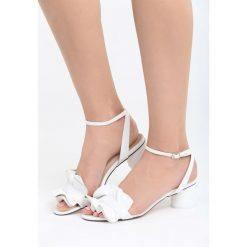 Białe Sandały Fly With Me. Białe sandały damskie na słupku marki Born2be, z materiału, na wysokim obcasie. Za 69,99 zł.