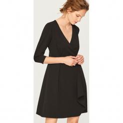Czarna sukienka - Czarny. Białe sukienki marki Reserved, l, z dzianiny. Za 119,99 zł.