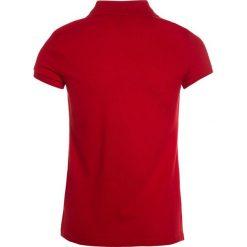 Polo Ralph Lauren Koszulka polo red. Niebieskie bluzki dziewczęce bawełniane marki Adidas, z kontrastowym kołnierzykiem, z krótkim rękawem. Za 209,00 zł.