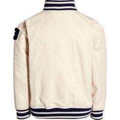Next Kurtka Bomber ecru. Białe kurtki dziewczęce przeciwdeszczowe Next, z bawełny. W wyprzedaży za 132,30 zł.