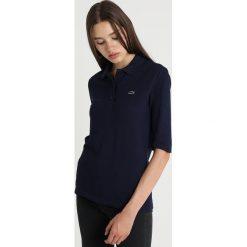 Lacoste TEE CORE Koszulka polo navy blue. Niebieskie bluzki damskie Lacoste, z bawełny, polo. Za 379,00 zł.