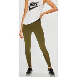 Nike Sportswear - Legginsy. Różowe legginsy marki Nike Sportswear, l, z nylonu, z okrągłym kołnierzem. Za 139,90 zł.