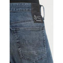 Denham BOLT Jeans Skinny Fit darkblue denim. Niebieskie rurki męskie marki Criminal Damage. Za 629,00 zł.