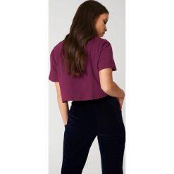 NA-KD Basic Krótki T-shirt oversize - Purple. Różowe t-shirty damskie marki NA-KD Basic, z bawełny. W wyprzedaży za 20,48 zł.