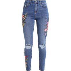 Topshop TUCAN  Jeans Skinny Fit middenim. Niebieskie jeansy damskie marki Topshop. W wyprzedaży za 271,20 zł.