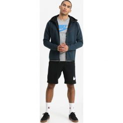 Nike Sportswear TECH FULL ZIP WINDRUNNER HOODIE Bluza z kapturem deep jungle/heather /black. Zielone kardigany męskie Nike Sportswear, m, z bawełny, z kapturem. W wyprzedaży za 359,10 zł.