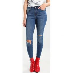New Look BRAMLEY  Jeans Skinny Fit mid blue. Czarne jeansy damskie marki New Look, z materiału, na obcasie. W wyprzedaży za 152,10 zł.