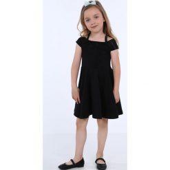 Sukienka dziewczęca na cienkich ramiączkach czarna NDZ8494. Szare sukienki dziewczęce na ramiączkach marki Fasardi. Za 49,00 zł.