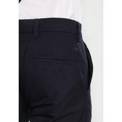 J.LINDEBERG ELOF SLIM FIT LIGHT Spodnie materiałowe navy. Niebieskie rurki męskie marki Tiffosi. Za 419,00 zł.