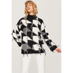 Sweter w szeroką pepitkę - Wielobarwn. Szare swetry klasyczne damskie marki FOUGANZA, z bawełny. Za 139,99 zł.