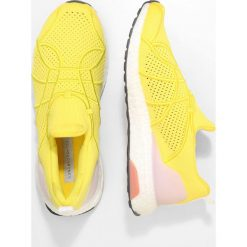 Buty do biegania damskie: adidas by Stella McCartney ULTRA BOOST UNCAGED Obuwie do biegania treningowe vivid yellow/white