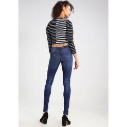 KIOMI Jeans Skinny Fit blue. Niebieskie jeansy damskie relaxed fit marki KIOMI. W wyprzedaży za 146,30 zł.