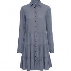 Sukienka bonprix dymny niebieski. Zielone sukienki z falbanami marki bonprix, w kropki, z kopertowym dekoltem, kopertowe. Za 129,99 zł.