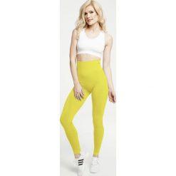 Gym Hero - Legginsy Yellow. Żółte legginsy sportowe damskie Gym Hero, m, z dzianiny. W wyprzedaży za 169,90 zł.