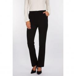 """Spodnie """"Castle"""" w kolorze czarnym. Czarne spodnie z wysokim stanem Scottage, z aplikacjami. W wyprzedaży za 90,95 zł."""