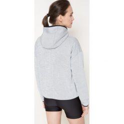 Under Armour - Bluza. Szare bluzy sportowe damskie marki Under Armour, l, z dzianiny, z kapturem. W wyprzedaży za 239,90 zł.