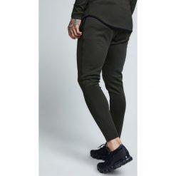 Spodnie dresowe męskie: SIKSILK ATHLETE TRACK PANTS Spodnie treningowe khaki