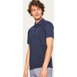 Koszulka polo z nadrukiem - Granatowy. Niebieskie koszulki polo marki Reserved, l, z nadrukiem. Za 59,99 zł.